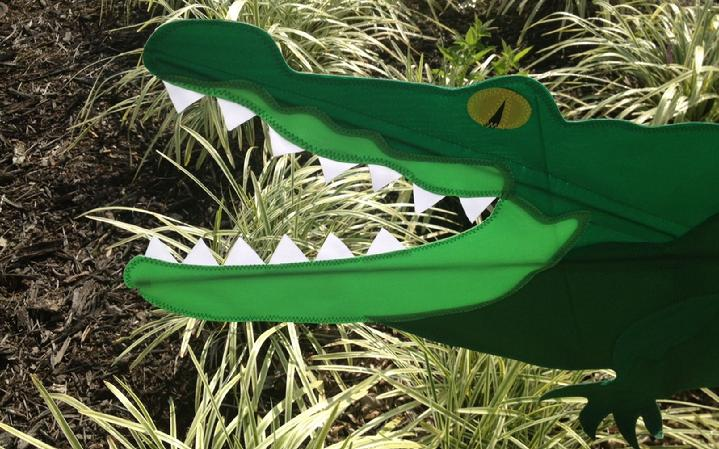 allie the alligator is a hungry alligator at bald eagle flag store, everyone loves allie the alligator