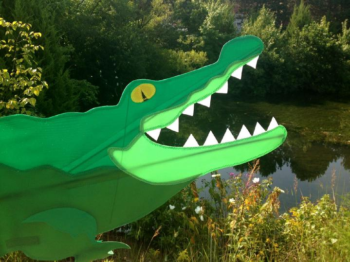 presenting allie the alligator spinner from bald eagle flag store fredericksburg va, alligator spinner whirligig rotates and spins in the wind,  call or visit bald eagle flag store when you are in fredericksburg va