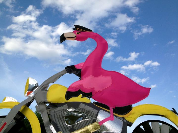 flamingo biker spinner at bald eagle flag store fredericksburg va, flamingo riding a motorcycle on route 3 at bald eagle flag store