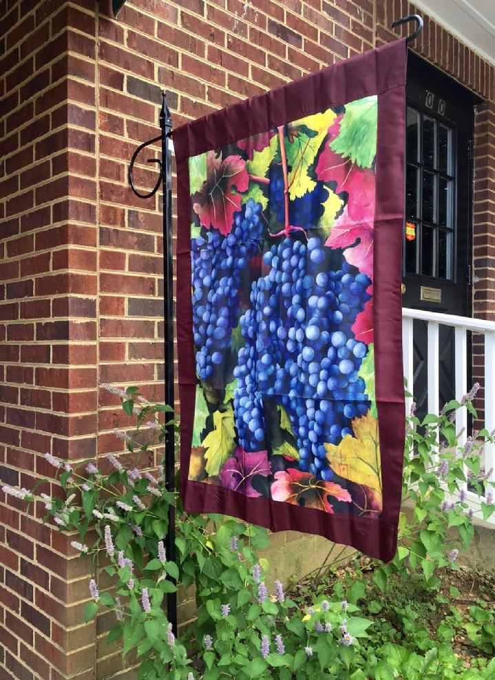 GRAPES FLAG FOR A VINEYARD BY BALD EAGLE FLAG STORE IN FREDERICKSBURG VIRGINIA 540-374-3480 PHOTOGRAPH BY BALDEAGLEINDUSTRIES.COM