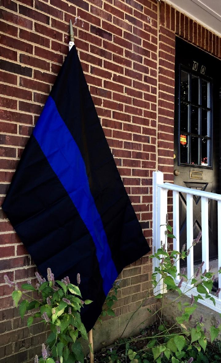THIN BLUE LINE FLAG BY BALD EAGLE FLAG STORE DIVISION OF BALD EAGLE INDUSTRIES 540-374-3480 PHOTOGRAPH BY BALDEAGLEINDUSTRIES.COM